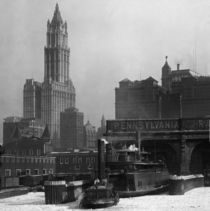 Woolworth building with Pennsylvania Railroad ferry in foreground