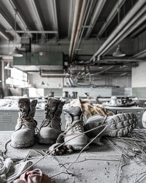 Workers shoes left on top of lockers in a factory locker room in Prypiat Ukraine