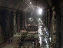 Workers walk through a massive eight-story cavern at the East Side Access project beneath midtown Manhattan The project will bring subway and commuter rail service to the far East and West sides of the city  Mary Altaffer AP