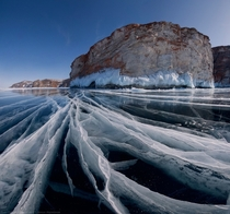 Worlds oldest lake Baikal Siberia covered in thick clear ice  Daniel Korzhonov  satorifoto