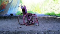 Wrecked spraypainted wheelchair in highway underpass near Helsinki
