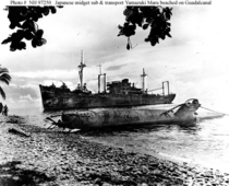 Wrecks of Japanese ship Yamazuki Maru and midget submarine on beach at Guadalcanal as photographed in  Photo credit to U S Army SSgt Heiberge May