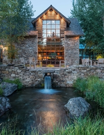 Wyoming Residence -Story Windows face Beautiful Stone Patio over Waterfall amp Pond