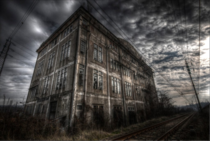x This is my last post for the day an abandoned steel mill by a railway line