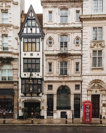 Ye Olde Cock Tavern a historic pub originally built before the th century and then rebuilt stuck between other architectural styles of Fleet Street the City of London UK