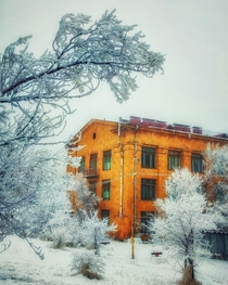 Yellow building surrounded with snow Yerevan