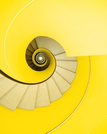 Yellow spiral staircase in a car park by Strausak Associs  Geneva Switzerland