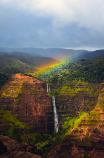 Yesterday a rainbow appeared over a hanging waterfall for about  minutes in Waimea Canyon Kauai HI