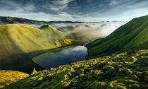 Yet another stunning capture of Iceland for rEarthPorn - The incredibly photogenic landscape of Iceland is illuminated after a sunrise a few hours earlier  Photo by Max Rive