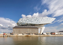 Zaha Hadid Architects designed huge faceted glass volume to sit on the roof of Antwerp port building
